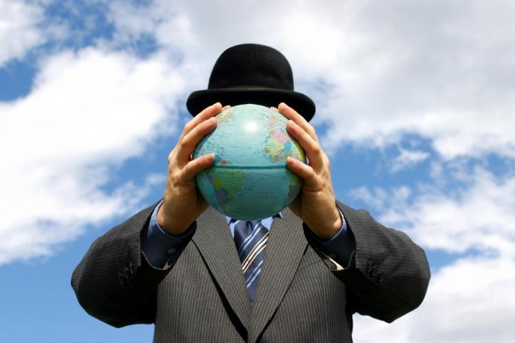 guy holding globe